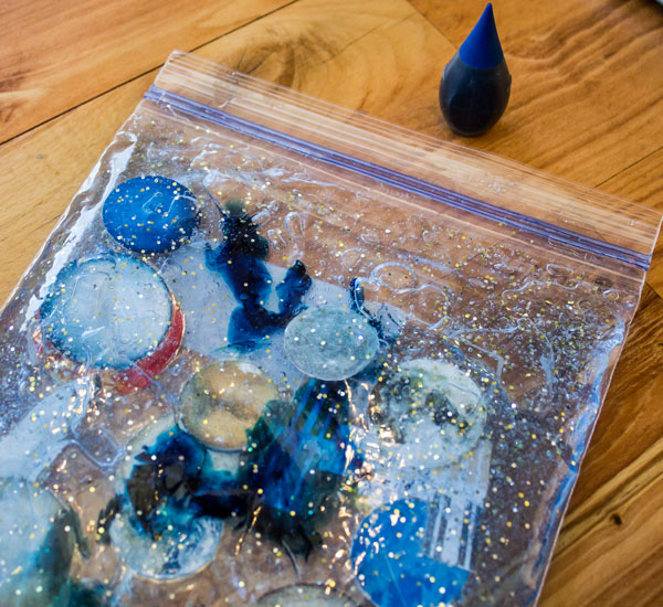 Add Food Coloring to Solar System Busy Bag