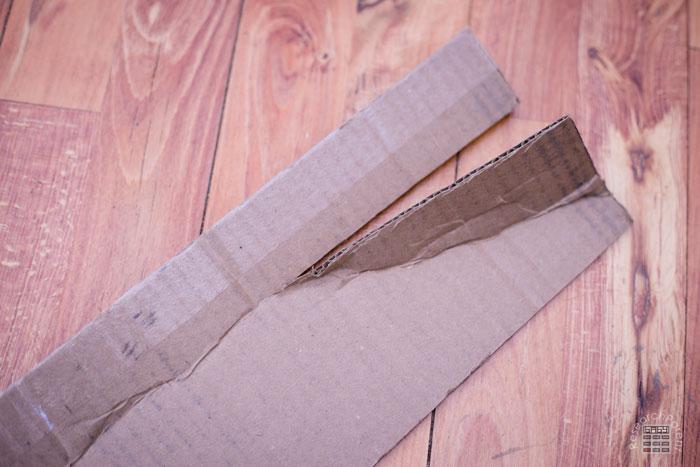 Cut slit in rectangular piece of cardboard