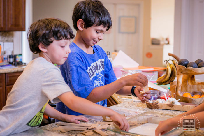 Kids having a lot of fun making papyrus paper