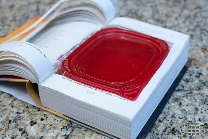 Flip a few pages to make it easier to put on the lid