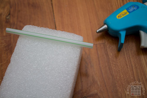 Hot glue straw onto foam