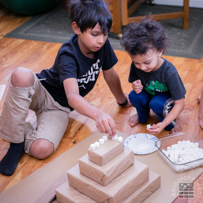 Glue sugar cubes onto ziggurat