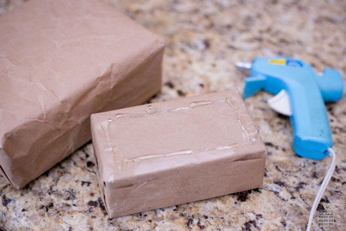 Glue the smallest box onto the next smallest