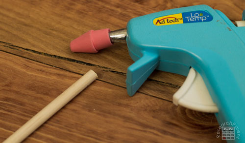 Hot Glue Erasers onto Ends of Arrows