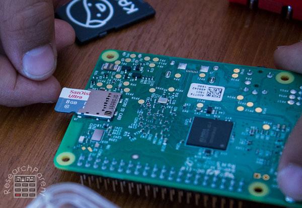 Insert micro SD card into raspberry pi