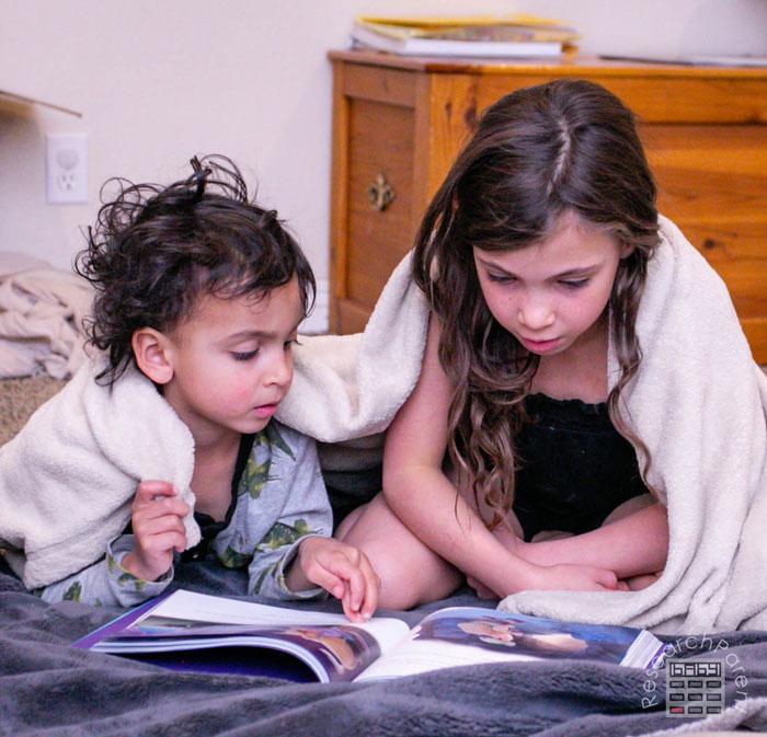 Kids Snuggled Up Reading