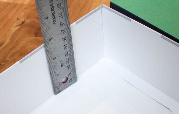 Measure the depth of the shoebox