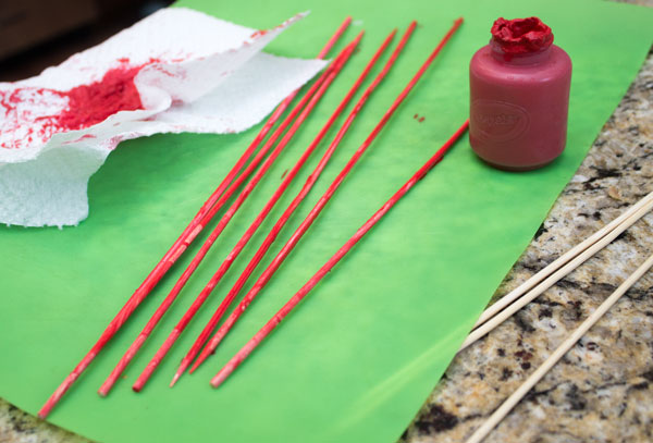 Paint Skewers Red for Palace Columns