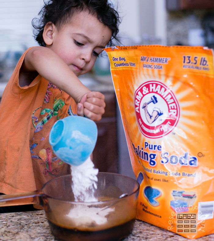 Pour baking soda into instant coffee mixture