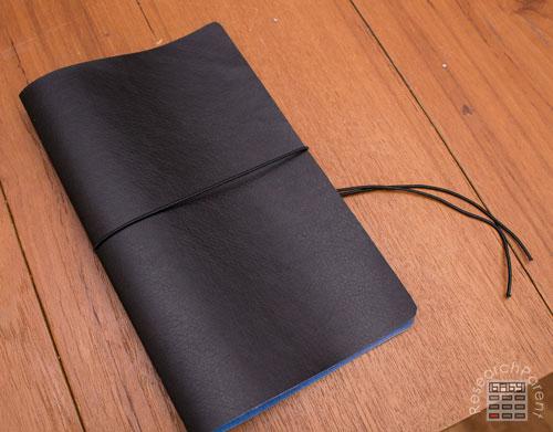 Pull elastic cord around book