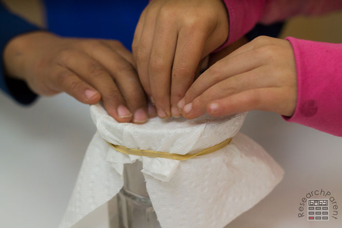 Push down the paper towel to create a well