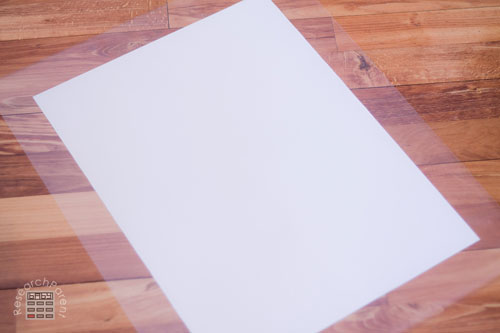 Push game board onto contact paper