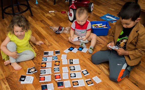 Kids using Solar System Cards