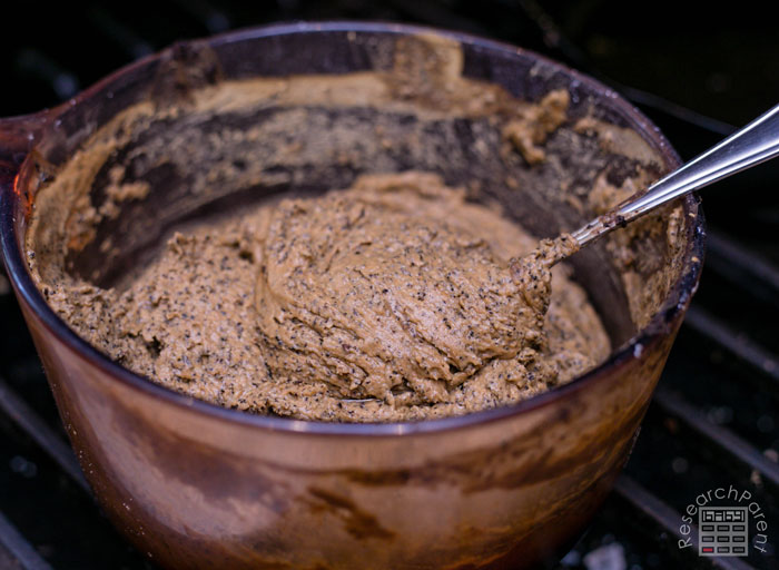 Stir mud clay as it cooks until consistency of mashed potatoes