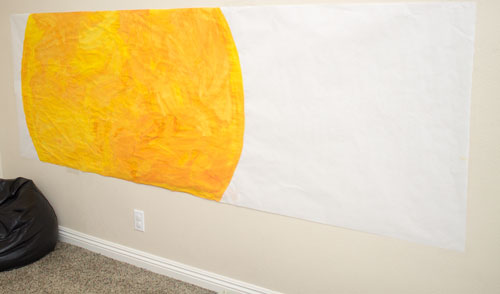 Tape Sun Poster to the Wall