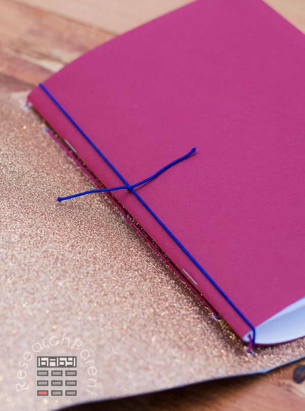 Tie cord around middle booklet