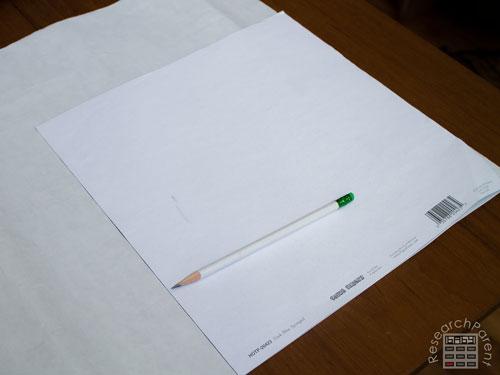 Trace scrapbook paper onto heat n bond paper
