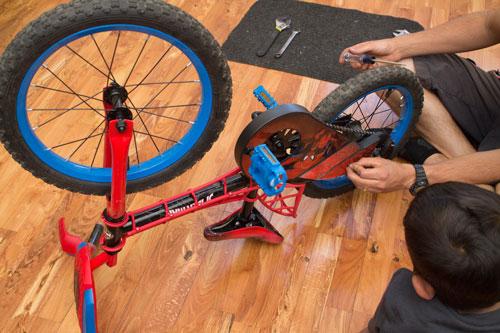 Turn bike upside down and take off chain guard