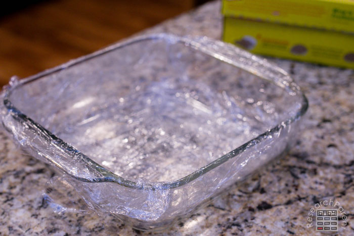 Use 2 sheets of plastic wrap on square dish