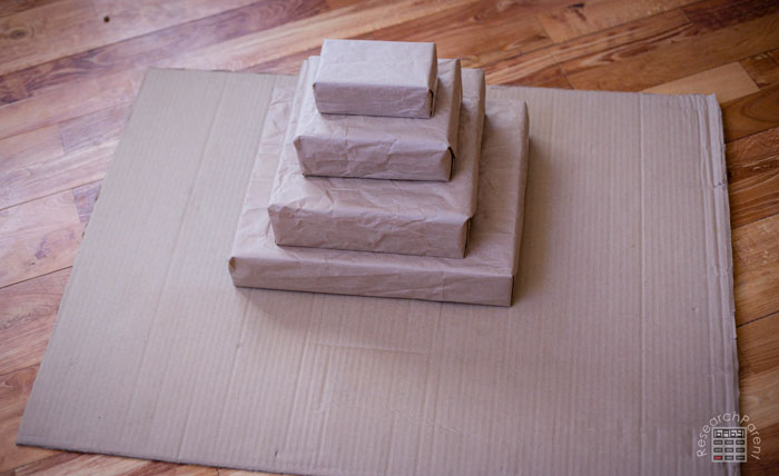 Use hot glue to stick the stack of boxes onto a base