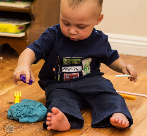 Baby playing with Play Dough